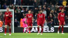 Indosport - Liverpool gagal menjadi kampiun Liga Primer Inggris 2018/19 hanya karena kalah satu poin dari Manchester City. Clive Brunskill/Getty Images.