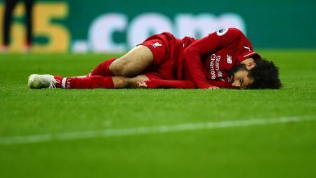 Pemain Liverpool, Mohamed Salah, terancam tidak bisa tampil melawan Crystal Palace setelah dipastikan absen membela Timnas Mesir di jeda internasional. - INDOSPORT