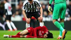 Indosport - Mohamed Salah mengalami cedera kepala saat pertandingan melawan Newcastle (5/5/19).