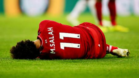 Mohamed Salah mengalami cedera kepala saat pertandingan melawan Newcastle United pada akhir pekan kemarin. - INDOSPORT
