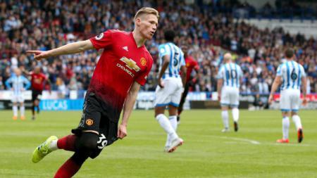 Scott McTominay mencetak keunggulan 1-0 untuk Manchester United ke gawang Huddersfield di Liga Primer Inggris, Minggu (05/05/19). (Foto: MUFC/Getty Images) - INDOSPORT