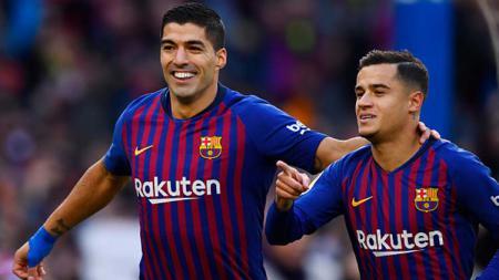 Luis Suarez (kiri) dan Pihilippe Coutinho yang kini bermain di Barcelona sama-sama pernah membela Liverpool. Gabriel Bouys/Getty Images. - INDOSPORT