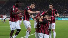 Indosport - Selebrasi para pemain AC Milan saat meraih kemenangan atas Bologna.