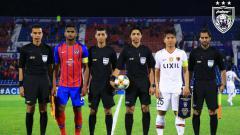 Indosport - Johor Daruz Takzim saat berhadapan dengan Khasima Antlers di kompetisi Liga Champions Asia.