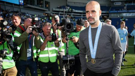Pelatih Manchester City, Pep Guardiola (Photo by Matthew Ashton - AMA/Getty Images). - INDOSPORT
