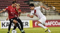 Indosport - Situasi pertandingan Lao Toyota FC vs PSM Makassar.