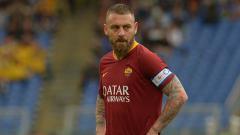 Indosport - Gelandang bertahan sekaligus kapten AS Roma, Daniele de Rossi.