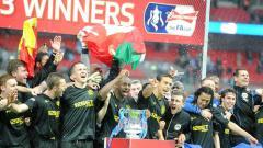 Indosport - Selebrasi kemenangan Wigan usai kalahkan Manchester City di final Piala FA,  Anthony Devlin - PA Images