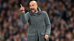 Indosport - Pep Guardiola, pelatih Manchester City.