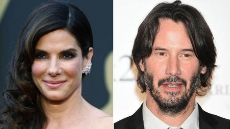 Aktris Sandra Bullock dan aktor Keanu Reeves (pemeran John Wick). - INDOSPORT