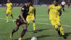Indosport - Situasi pertandingan PSM Makassar vs Semen Padang.