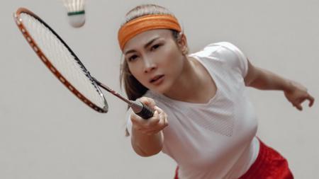 Andrea Dian Bimo saat bermain bulutangkis - INDOSPORT