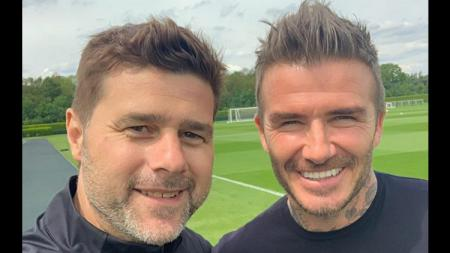 David Beckham bertemu Mauricio Pochettino di tempat latihan Tottenham Hotspur. - INDOSPORT