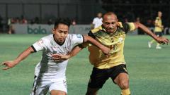 Indosport - Aksi Andik Vermansyah di laga Barito Putera vs Madura United, Jumat (24/05/19).