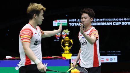Marcus Gideon (kiri) & Kevin Sanjaya (kanan) - INDOSPORT
