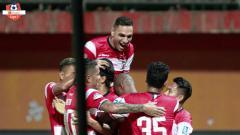 Indosport - Selebrasi pemain Madura United di laga kontra Borneo FC, Selasa (28/05/19).