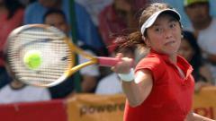 Indosport - Wynne Prakusya, ratu tenis Indonesia, peraih emas SEA Games 2005 Manila. Foto: JAY DIRECTO/AFP/Getty Images