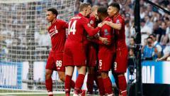 Indosport - Selebrasi skuat Liverpool saat merayakan gol pembuka Mohamed Salah