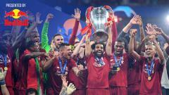 Indosport - Tim Liverpool melakukan selebrasi juara Liga Champions. Michael Regan/Getty Images