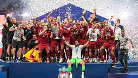 Kegembiraan ditunjukan oleh para pemain Liverpool keluar sebagai juara Liga Champions musim ini. TF-Images/Getty Images