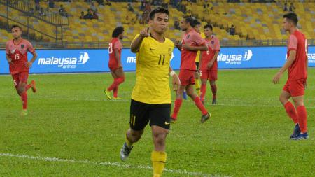 Pemain Malaysia Shahrul Saad usai mencetak gol ke gawang Nepal, Minggu (02/06/19). - INDOSPORT