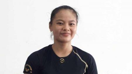 Lifter Windy Cantika Aisah membawa pulang medali emas cabang olahraga angkat besi SEA Games 2019. Foto: Mercy Raya/detikSport - INDOSPORT