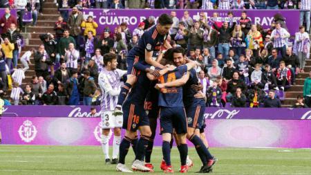 Selebrasi pemain Valencia, usai mencetak gol ke gawang Real Valladolid di pekan terakhir LaLiga. - INDOSPORT