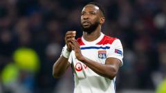 Indosport - Bintang Lyon, Moussa Dembele, yang diincar Arsenal dan Liverpool.