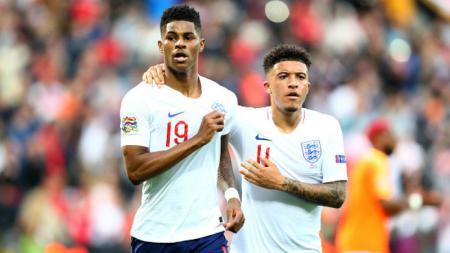 Jadon Sancho (kanan) jadi salah satu pemain yang pernah memperkuat klub Liga Inggris, Manchester City. - INDOSPORT