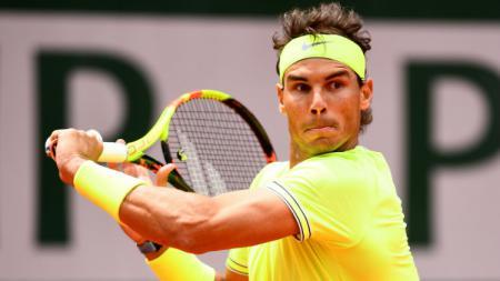 Rafael Nadal sukses menumbangkan Roger Federer di semifinal Prancis Terbuka 2019, Jumat (07/06/19). - INDOSPORT