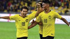 Indosport - Selebrasi Timnas Malaysia di pertandingan putaran pertama Kualifikasi Piala Dunia 2022 zona Asia. (Foto: the-afc.com)