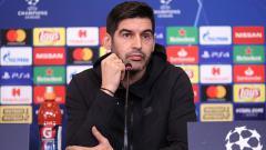 Indosport - Paulo Fonseca saat konferensi pers di Liga Champions