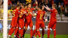 Indosport - Selebrasi kemenangan dari para pemain Belgia, Jimmy Bolcina / Photonews via Getty Images