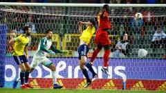 Indosport - Proses gol pertama Lukaku di laga Belgia vs Skotlandia, Jimmy Bolcina / Photonews via Getty Images