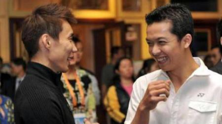 Lee Chong Wei bersama legenda bulutangkis Indonesia, Taufik Hidayat. - INDOSPORT