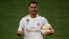 Indosport - Eden Hazard saat diperkenalkan oleh Real Madrid.