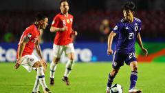 Indosport - Takefusa Kubo mampu merepotkan pemain Chile dalam Copa America 2019 di stadion Morumbi. (06/18/19). Chris Brunskill/Fantasista/Getty Images