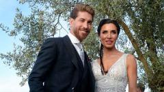 Indosport - Tak mau kalah dari Ronaldo, Sergio Ramos juga lakukan liburan bersama pasangannya.