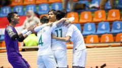 Indosport - Timnas Futsal Indonesia U-20 merayakan gol di Piala AFC Futsal U-20 2019, Kamis (20/06/19).