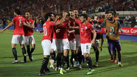 Aksi selebrasi Timnas Mesir setelah Trezeguet mencetak gol ke gawang Zimbabwe pada laga pembuka Piala Afrika 2019 di Cairo International Stadium.