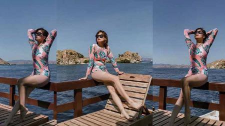 Chika Jessica saat berlibur di salah satu pantai. - INDOSPORT