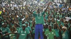 Indosport - Suporter setia Timnas Burundi yang bakal mendukung negaranya di Piala Afrika 2019,Cemil Oksuz/Anadolu Agency/Getty Images