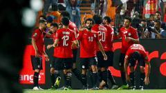 Indosport - Mohamed Salah merayakan gol saat laga Mesir vs Kongo di Piala Afrika 2019, Kamis (27/06/19).