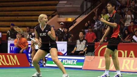 Hendra Setiawan dan Anastasia Russkikh memiliki momen yang tak pernah terlupakan di turnamen bulutangkis All England 2011. - INDOSPORT