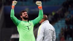 Indosport - Alisson Becker saat memperkuat Timnas Brasil di Copa America 2019.