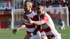Indosport - Aleksandar Rakic gabung Barito Putera jelang Liga 1, lantas bagaimanakah rekam jejak striker asing asal Eropa bersama Djajang Nurdjaman?
