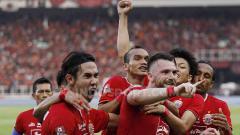 Indosport - Aksi selebrasi pemain Persija Jakarta setelah Marko Simic mencetak gol ke gawang Persib Bandung.