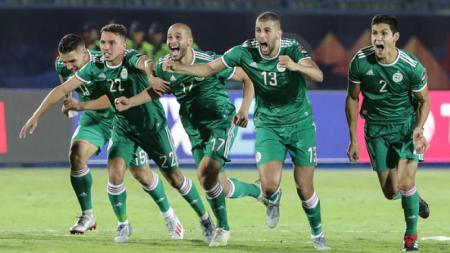 Selebrasi kemenangan Aljazair atas Pantai Gading di Piala Afrika 2019, Oliver Weiken/picture alliance via Getty Images - INDOSPORT