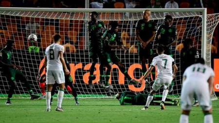 Gol Riyad Mahrez bawa Aljazair menang 2-1 atas Nigeria di semifinal Piala Afrika 2019 (15/07/19) - INDOSPORT