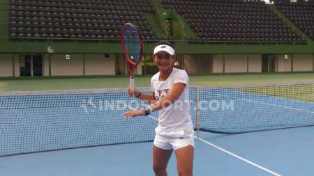 Petenis Indonesia, Priska Madelyn Nugroho membeberkan perbedaan atmosfer di dua turnamen tenis Grand Slam, yakni Wimbledon dan AS Terbuka 2019. Foto: Petrus Manus Da'Yerimon/INDOSPORT. - INDOSPORT
